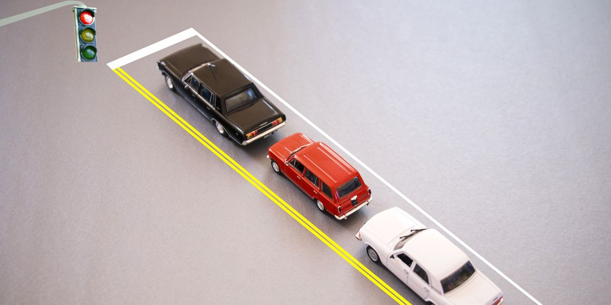 How much space should you keep between the car ahead at red lights?