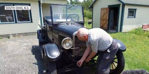 Pitman crank-starts his '27 Ford Model T pickup.