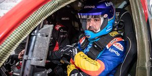 Fernando Alonso looks right at home in the cockpit of a Toyota Hilux rally truck.