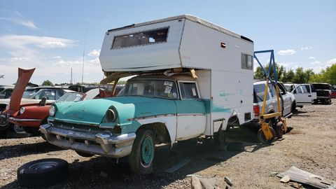 Sometimes your local junkyard offers the utterly unexpected, such as a '56 Mercury camper next to a Fiat 850 Spider.