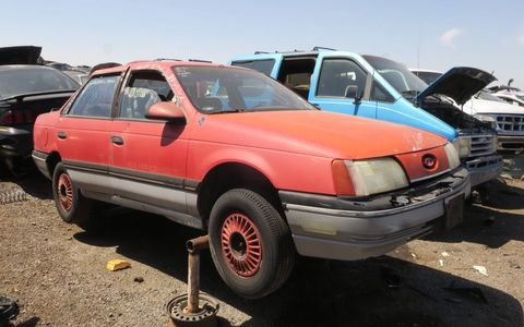 One of the rarest of all junkyard finds: a (non-SHO) Taurus with manual transmission.