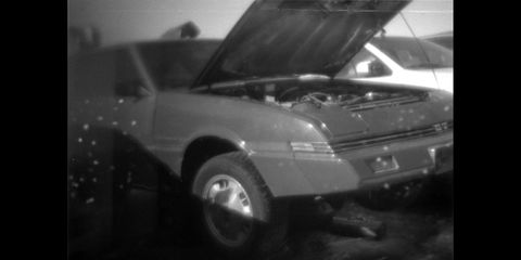 A very rare narrow-body 1983 Mitsubishi Starion, captured in a Denver wrecking yard by the 1980s Kellogg's Corn Flakes 110 film camera.