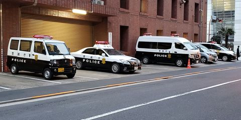 Police station in Shinjuku, Tokyo. Police vehicles, left to right: Nissan Clipper, Toyota Crown, Nissan Caravan, Toyota Estima.
