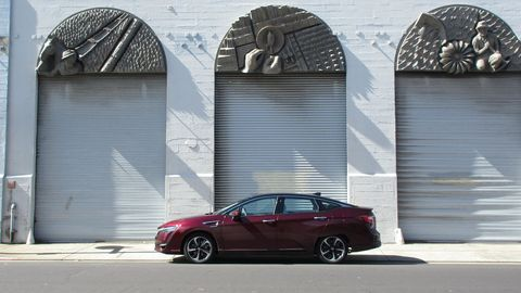 The Art Deco ornamentation on the old Pacific Gas & Electric building in Emeryville seemed to go well with the futuristic fuel-cell Honda.