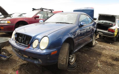 Early 2000s C-Classes are not uncommon in this kind of wrecking yard, but genuine AMGs are almost unheard of.