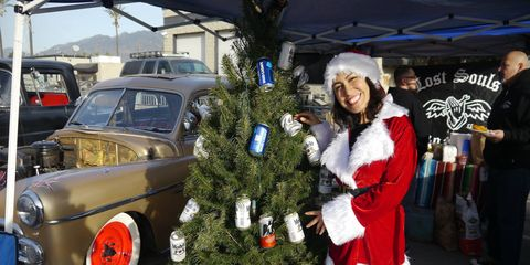How do you know it's Christmas in SoCal? When you see the long lines around Irwindale for the Mooneyes X-mas Party Show & Drag! Ho ho ho! It's a huge car show with hundreds of lead sleds, bombs, rat rods and kustoms, and this year exactly 100 race cars showed up for the 1/8-mile drags! They put the X in X-mas!
