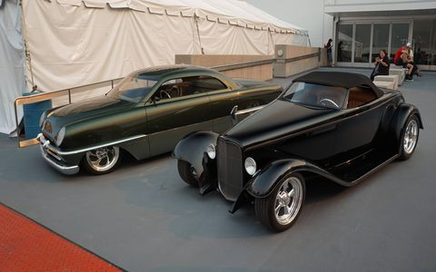 "Outside on the upper floor of the museum's parking garage, Foose creations were parked beside other hot rods. That's Troy Trepanier's ""Sniper"" on the left, which was built from a Chip Foose drawing."