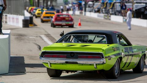 Lineup of American muscle as Richard Goldsmith waves from his Sam Posey '70 Dodge Challenger.