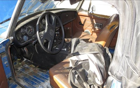 Because the top is reasonably intact, the interior isn't as ruined as most junkyard convertibles.