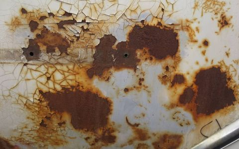 Not much rust-through, but the paint has been nuked by the sun in many places.