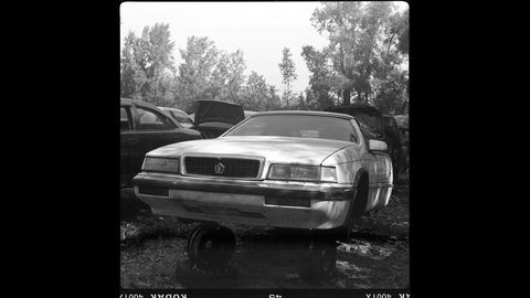 An Italianate Chrysler LeBaron in a Wisconsin wrecking yard, photographed with a 1940 Ansco Speedex film camera.