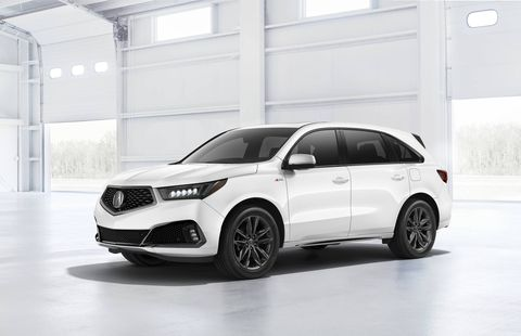 The 2019 Acura MDX midsize crossover is on sale now, and the big news -- alongside transmission refinements and the rollout of standard start-stop -- is the addition of the A-Spec trim. It adds 20-inch aluminum alloy wheels, a unique front fascia, larger-looking exhaust outlets and more, plus a variety of sport-oriented interior features. A-Spec trim is shown.