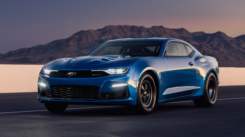 """Chevrolet's electric eCOPO Camaro concept could revolutionize drag racing. With two Borg Warner electric motors under the hood driving the rear wheels through a torque-converter automatic transmission, the 700-hp beast does the quarter in the high nines at trap speeds as fast as 140-plus mph. The NHRA is said to be """"receptive"""" to the concept."""