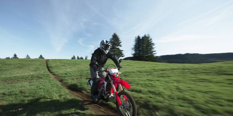 The new CRF450L is a dirt bike you can ride on the street, a so-called dual sport. It's powered by a 450cc single cylinder that moves the bike's 289 pounds up any trail you aim it at. Or at which you aim it, if you're an English major.