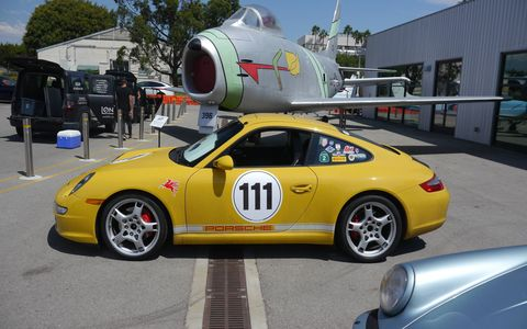 The Porsche Club of America's Los Angeles Region held its 56th Concours d'Elegance on Sunday at the Santa Monica Museum of Flying. 250 cars showed up. The planes were already there. Lovely day. Here a 911 basks beneath a North America F-86H Sabrejet.