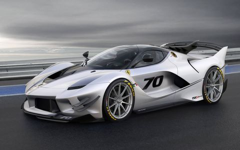 After a year of CFD simulations and wind tunnel testing, Ferrari came out with this, the FXX-K EVO, the latest in the semi-experimental and very limited-production XX program, which was launched in 2005. This car makes 1411 pounds of downforce at 124 mph and 1830 pounds when the car is running at redline. Wow!