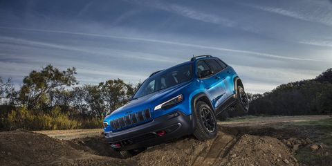 The 2019 Jeep Cherokee gets about half a complete makeover, including a more mainstream grille and a new turbo four, all while remaining just as confident off-road. Look at that left rear tire!