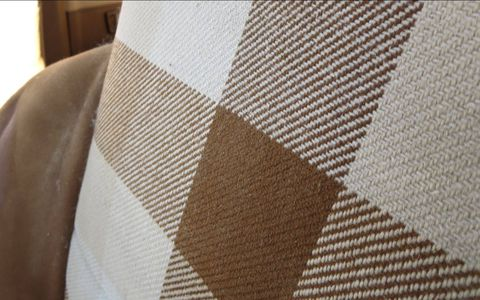 Brown-and-beige checked cloth seats.