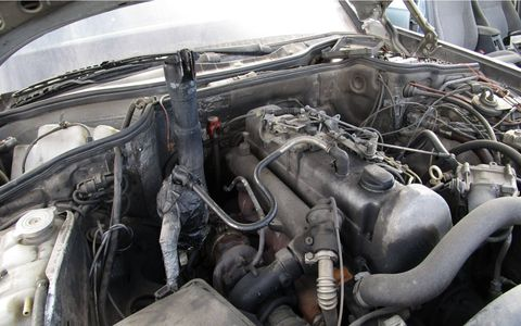 Exhaust systems are too complicated! Best to take the tailpipe right through the hood.