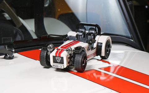 The Lego Caterham Super Seven poses on the hood of the real thing.