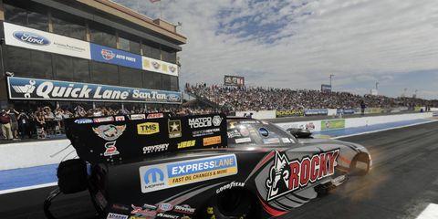 Matt Hagan won the NHRA Funny Car event from the top qualifying spot on Sunday in Arizona.