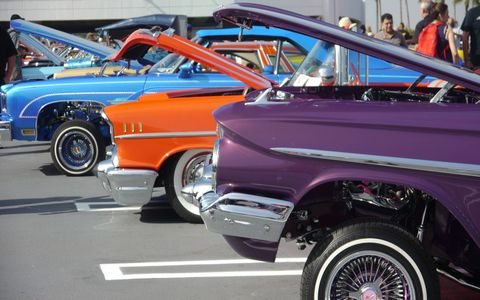 """Almost 100 lowriders converged on the Petersen Automotive Museum in Los Angeles Sunday to commemorate and celebrate the museum's new exhibit, """"The High Art of Riding Low."""" Since the exhibit opened last month, attendance has gone up 50 percent."""