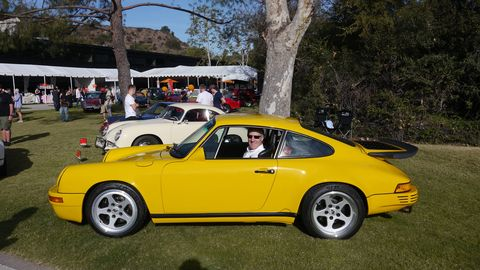 Collector car icon Bruce Meyer in his Yellow Bird.