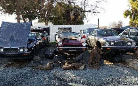 In its final parking space, flanked by Jaguar XJ6s of the 1980s and 1990s.