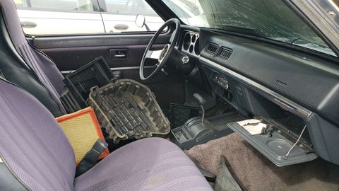 Bucket seats, automatic transmission. No air conditioning, but otherwise a pretty luxurious econobox, by 1982 standards.