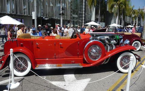The 24th annual Rodeo Drive Concours d'Elegance was held under perfectly Beverly Hills blue skies on four blocks of the world's best shopping street. With over 100 cars and probably 20,000 people it is the single biggest event that happens in the city all year. And it's free! Happy Fathers' Day!