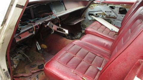 Most of the interior had been purchased by junkyard shoppers before I got there, but the Bordello Red front bucket seats remained.