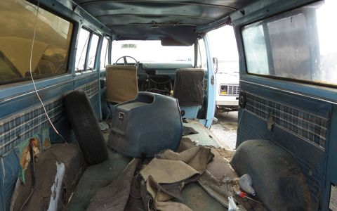 When new, this van had two big bench seats in back and seated 8.