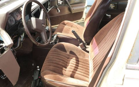The interior is standard early-'80s GM fuzzy cloth and hard plastic.