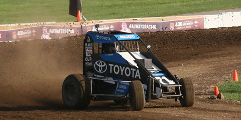 Tony Stewart takes his turn on a special dirt track built for him in turn 3 at Indianapolis Motors Speedway.