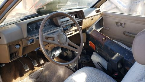 The interior is very typical of Japanese econoboxes of the late 1970s. The steering wheel is sporty in the Mitsubishi style of the era.