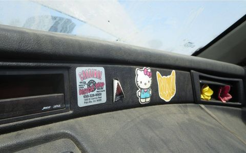 The car's final owner liked to slap stickers on every surface.
