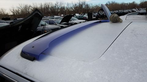 I'm pretty sure the purple plastic sunroof wind deflector is an aftermarket item.
