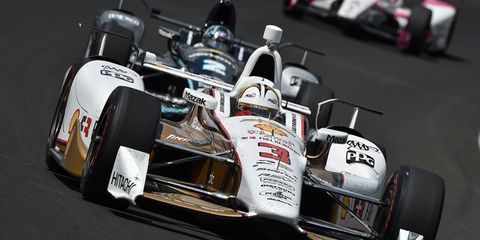 Helio Castroneves was fastest in final practice for the Indianapolis 500.