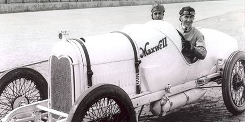 In 1916, drivers Eddie Rickenbacker, right, and Peter Henderson became the first drivers in Indy 500 history to wear steel helmets. Note that the helmets aren't shown in this parade photo. The drivers didn't put them on until the race.