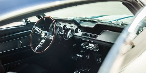 Revology makes up the replica Mustangs with period-correct interiors.