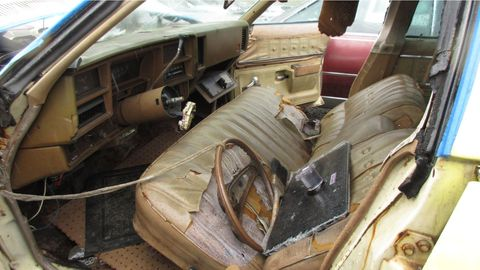 This one had a 44-year career, and it shows every day of its life in the battered interior.