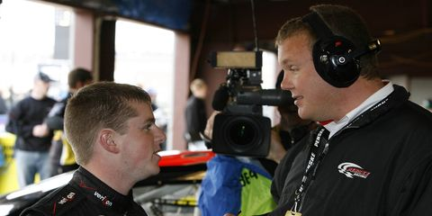 Darlington Raceway president Chip Wile, shown here talking with Justin Allgaier in 2009, is prepping to drive a stock car in a charity race.