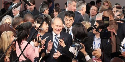 Event, Camera, Journalist, Cameras & optics, Video camera, Audience, Public event, News conference, Tie, Camera accessory,