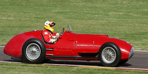 """Gonzales, """"the Wild Bull of the Pampas,"""" scored Ferrari's first GP victory in this 375. After Massa burned donuts with the precious ikon in Saturday's Fiorano demo, it was given to test pilot Badoeur for Sunday. But he couldn't keep his own wild bull foot out of the 4.5 V12."""