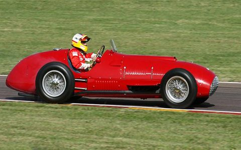 "Gonzales, ""the Wild Bull of the Pampas,"" scored Ferrari's first GP victory in this 375. After Massa burned donuts with the precious ikon in Saturday's Fiorano demo, it was given to test pilot Badoeur for Sunday. But he couldn't keep his own wild bull foot out of the 4.5 V12."