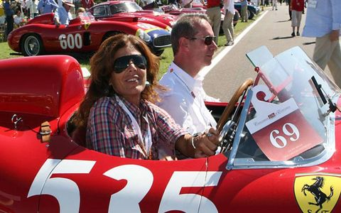 "Prisca Taruffi, daughter of Piero, again drove the magnificent ""535"" that won the last Mille Miglia in 1957. Alongside is the head of Ferrari's Classiche restoration department, Roberto Vaglietti"