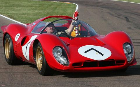 Concours co-winning P4, said to be the only one of 1967's original three to remain unmolested—the others were turned into Can-Am spyders. Driver is holding trophy baton that illustrates all 60 years of Ferrari history