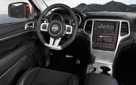 Carbon fiber trim outside and a flat-bottom steering wheel on the inside don't seem out of place on the Jeep Grand Cherokee STR8, even if it remains a big SUV.
