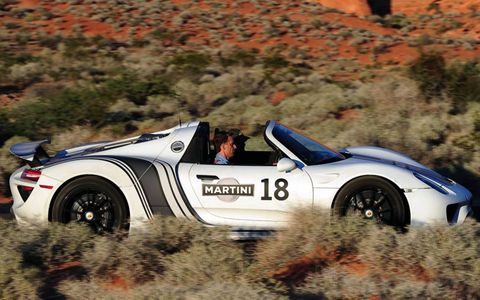 The Porsche 918 spyder in Martini Racing livery testing in the desert.
