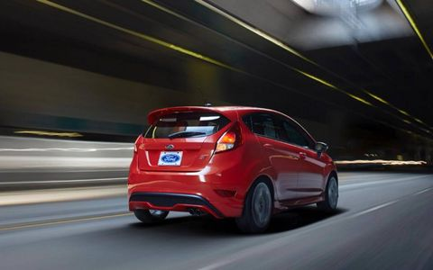 The rear suspension on the 2014 Ford Fiesta ST utilizes a beefed-up twist-beam axle, while the front uses a modified ST-designed MacPherson setup.